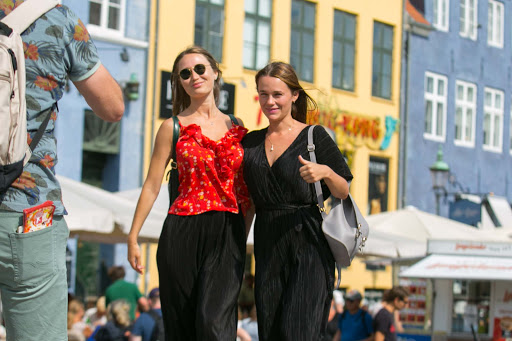 Visitors pose with a picture-perfect backdrop in Copenhagen's Nyhan district.