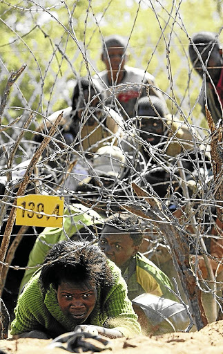 Zimbabweans cross the border into SA illegally. Most refugees don't want to be tested for Covid-19 for fear of deportation. /JAMES OATWAY
