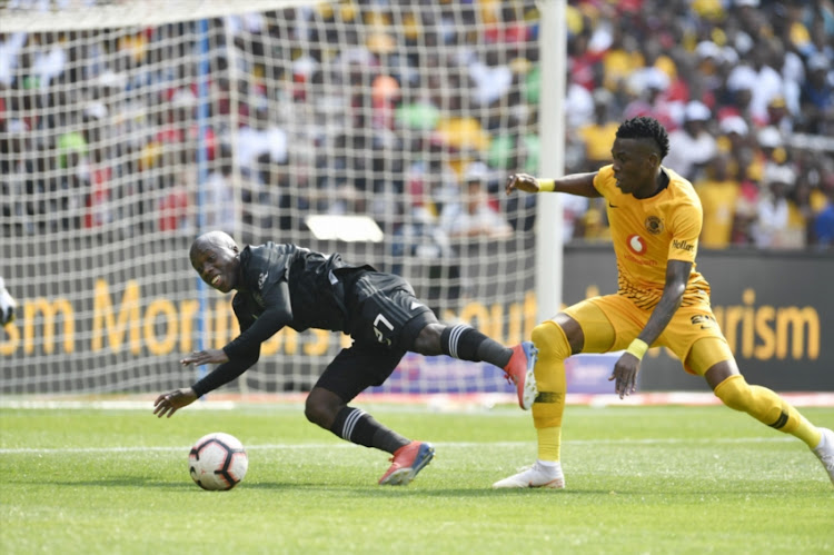 Ben Motshwari of Kazier Chiefs and Teenage Hadebe of Orlando Pirates during the Absa Premiership match between Orlando Pirates and Kazier Chiefs at FNB Stadium on February 09, 2019 in Johannesburg, South Africa.