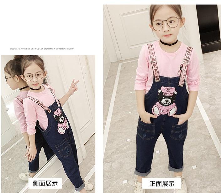 spodnie ogrodniczki jeansowe z dziurami dla dziewczynki9