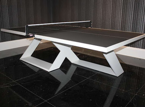 A white and black table tennis table with crossed-legs