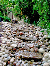 Photo: Using flagstone in a creekway amplifies sound.