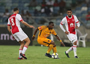 George Maluleka of Kaizer Chiefs and Roscoe Pietersen of Ajax Cape Town battle for the ball during the Absa Premiership match between Kaizer Chiefs and Ajax Cape Town at Moses Mabhida Stadium on December 16, 2017 in Durban, South Africa.
