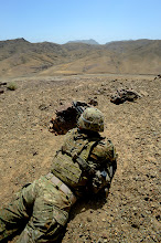 Photo: U.S. Army Staff Sgt. Todd Hobbs, squad leader, secures an area during a land survey in Arghandab, Afghanistan, July 20, 2011. Sergeant Hobbs is a member of Provincial Reconstruction Team Zabul's security force and is deployed from the Massachusetts National Guard. PRT Zabul's mission is to conduct civil-military operations in Zabul Province to extend the reach and legitimacy of the Government of Afghanistan. (U.S. Air Force photo/Senior Airman Grovert Fuentes-Contreras)(Released)