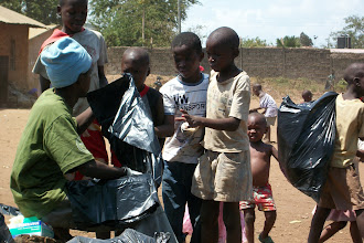 Photo: October - 16th - Community Trash Removal and Tree Planting. Residents (mostly kids) were given bags and gloves.