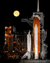 Photo: A nearly full Moon sets as the space shuttle Discovery sits atop Launch pad 39A at the Kennedy Space Center in Cape Canaveral, Florida, Wednesday, March 11, 2009.  Photo Credit: (NASA/Bill Ingalls)
