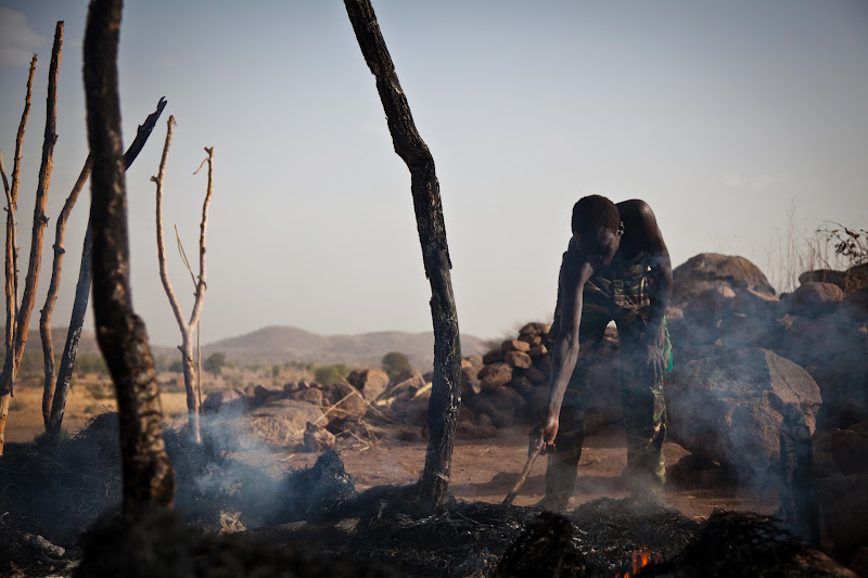 Photo: A man looks through the remains of a house destroyed by a Sudan Armed Forces airstrike, in Tabanya, in South Kordofan, a region of Sudan