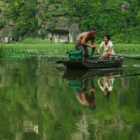 Boatpersons in Vietnam by Ajay Sood - Landscapes Travel ( ajay sood, ajay, sood, reflections, vietnam, travelure, pwcreflections-dq )