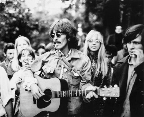 George Harrison at Hippie Hill.  Harrison was handed a guitar and asked to strum.
