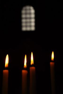 candele in chiesa di Clara