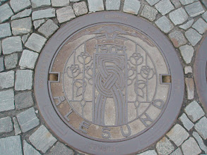 Photo: Fancy manhole covers. These were common throughout all the cobblestone streets in Norway.