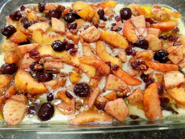 Spoon fruit evenly over batter. Place into oven and bake for 55 minutes.
