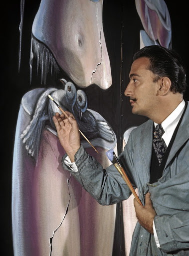 Salvador Dali works on the figure of two birds in a large oil composition, Greenwich Village, New York.