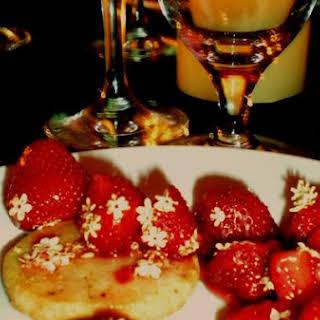 Strawberries With Elderflower Syrup And Cream.