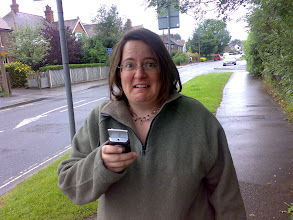 Photo: Kim plots our course to Dave and Jen's house, using only the power of GPS.