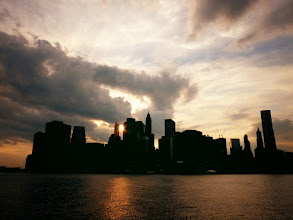 """Photo: """"Fever dream...""""  New York Photography: The New York City skyline.   I used to refer to sunsets as sunfire.  Those first sunsets burned through my retinas into the innermost recesses of my mind.  Clouds poured over the smoldering sparks of orange like thick plumes of smoke and before the sun extinguished itself, it burned the brightest of any flame in existence.  When the sun sets over New York City, it's as if a thousand flames dance across the sky, leaving embers scattered across the skyline in the wake of it's burning: like a fevered dream scattering its remnants across the mind before the deepest of slumbers.  I used to refer to sunsets as sunfire.  I still do.    You can view this post if you wish at my site here:  http://nythroughthelens.com/post/14268723774/the-new-york-city-skyline-in-silhouette-at    Where to purchase my photography on prints, posters, cards and other gifts:  http://goo.gl/nJiKc    Tags: #photography #writing #prose #poetry #newyorkcity #newyorkcityphotography #skyline #cityscape #landscape #skyscrapers #nyc #manhattan"""