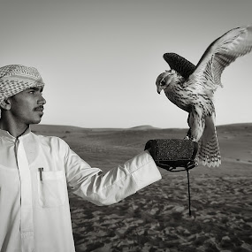 Falconry by Marco Parenti - Black & White Portraits & People ( desert, black and white, falcon, abu dhabi, falconry, people )