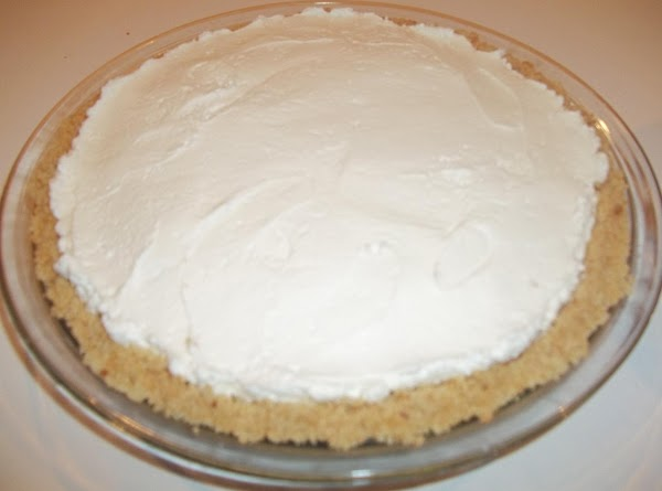 In a large bowl, beat the cream cheese, confectioners' sugar, liqueur and vanilla until...