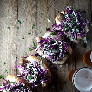 Italian Sausage with Cabbage & Spring Onion Slaw & Jalapeno Aioli