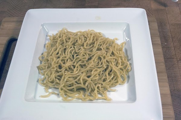 Add the noodles to a serving dish.