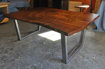 Photo: http://dorsetcustomfurniture.blogspot.com/2012/07/claro-walnut-slab-desk-with-secret.html  http://dorsetcustomfurniture.blogspot.com/p/stuff-for-sale.html