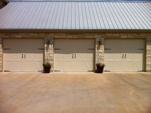 Photo: Amarr Classica Doors with Decorative Hardware. Built by Cedar Park Overhead Doors 512-335-7441
