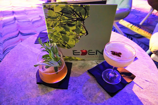A selection of the specialty cocktails, available only at the Eden Bar on Celebrity Edge, includes fresh ingredients picked from the Library of Plants located behind the bar.