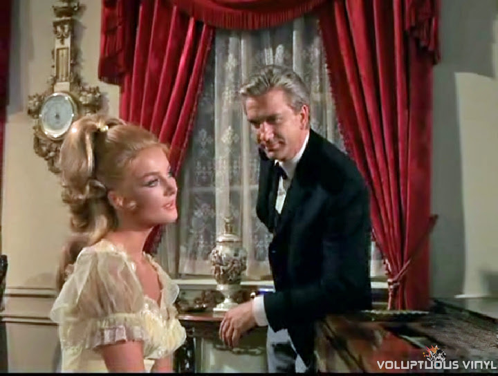 Barbara Bouchet plays the piano while Leslie Nielsen gazes at her, in The Virginian