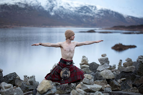 Man in Kilt doing Yoga Poses in Scotland | Krys Kolumbus Travel