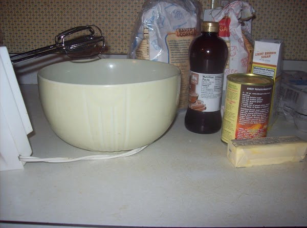 Mix ½ cup butter and brown sugar together in a large bowl, until blended...