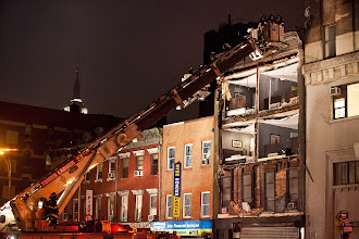 Photo: NEW YORK, NY - OCTOBER 29:  Fire fighters evaluate the scene of an apartment building which had the front wall collapse due to Hurricane Sandy on October 29, 2012 in New York, United States. Hurricane Sandy, which threatens 50 million people in the eastern third of the U.S., is expected to bring days of rain, high winds and possibly heavy snow. New York Governor Andrew Cuomo announced the closure of all New York City will bus, subway and commuter rail service as of Sunday evening  (Photo by Andrew Burton/Getty Images)