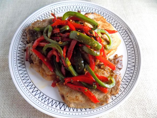 Place pork chops on plate and top with the garlic, peppers and jalapeno mix....