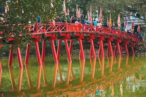 hanoi-vietnam-bridge-river-orchid.jpg -  Locals cross a picturesque bridge in Hanoi, Vietnam, during a Uniworld cruise in River Orchid.