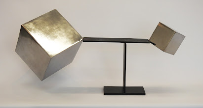 Photo: TRIUMPH OF SMALL - 18H X 31W X 12D Polished and Painted Mild Steel and Lead, Interactive Kinetic, Front View