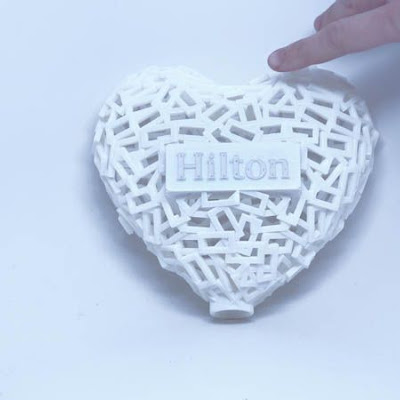 3d printing gallery image of a white heart trophy made in sls nylon for a corporate award executive gift