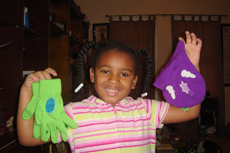 Photo: beautiful gloves and hat he made at school for her