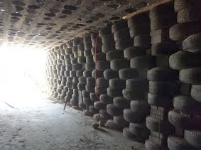 Photo: Shot from underground parking looking west toward the street with nearly 1000 earth rammed tires on the wall and 800 buckets in ceiling.