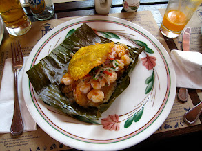 "Photo: This dish is a freshwater trout and shrimp ceviche over rice, combined with a smashed plantain known as a ""patacón"", wrapped in a banana leaf and then steamed."
