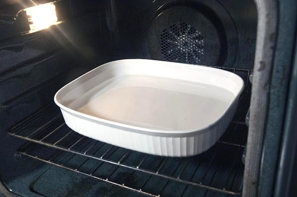 Create a bain-marie and place in the oven.