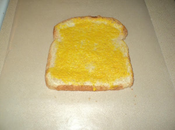 Flatten each slice of trimmed bread with rolling pin. Spread slices with mustard.(my picture...