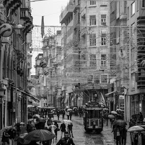 by Giorgos Latsouris - City,  Street & Park  Historic Districts ( umbrella, tram, istanbul, running, rain, man,  )