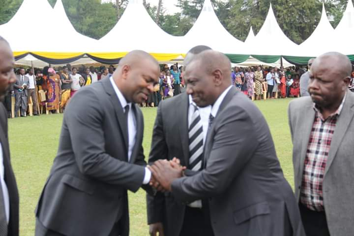 Ex-Sports CS Rashid Echesa welcomes DP William Ruto at the funeral service for Ikolomani MP Bernard Shinali's son on Friday.