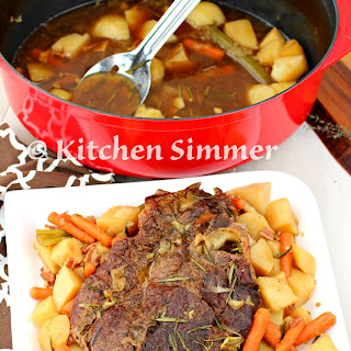 Classic Beef Pot Roast with Potatoes and Carrots.