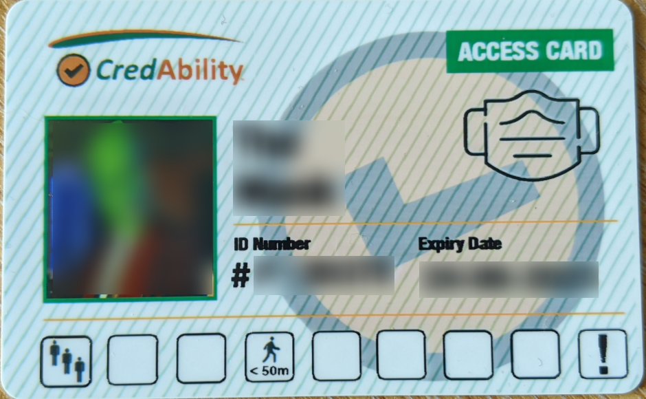 access card featuring mask exemption symbol