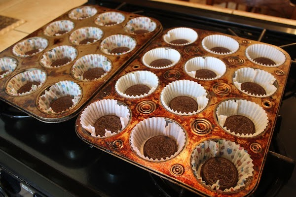 Take your Oreo's and place one at the bottom of each cupcake liner.