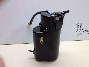 Photo: Fuel pump housing, mounted in the battery box.  It was originally mounted in the bottom of the Versys fuel tank.