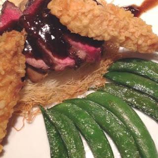 Oriental Filet Mignon on Crisp Kataifi with Shrimp Tempura.