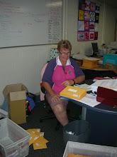 Photo: Kath - hard at work posting our Member handbooks :) - Nov 09