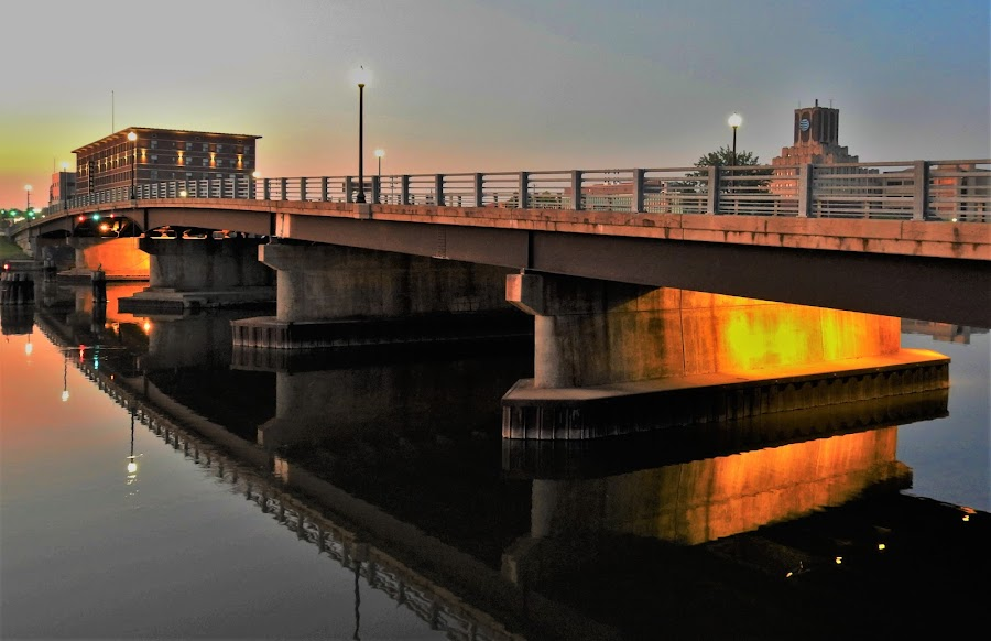 Golden Reflections by Kathy Woods Booth - Buildings & Architecture Bridges & Suspended Structures ( sunrise, reflections, waterscape, cityscape, dawn, bridge, office, mirrored reflections, suspended )