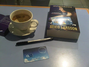 Photo: At the airport years early. All is well. Trying to fortify myself with coffee and calm myself with some Stieg Larsson (RIP) and maybe activate a UK SIM. Maybe not. Should have done that before coming. Oh well. All went well.